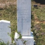Headstone for John Marshall Roquemore (1830-1911); partial CSA headstone on left.